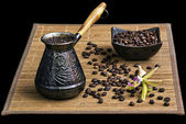 Coffee turk with coffee beans and orchid — Stock Photo
