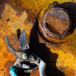 Rusty metal background and tool with a shadow — Stock Photo
