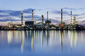 River and oil refinery factory with refection — Stock Photo