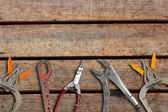 Workshop Tool on wooden wall — Stock Photo
