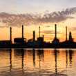 Stock Photo: Sunrise, oil refinery factory with refection in Bangkok, Thailand.
