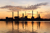 Sunrise, oil refinery factory with refection in Bangkok, Thailand. — Stock Photo