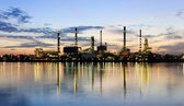 PANORAMA River and oil refinery factory with reflection — Stock Photo