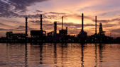 Lonely, Sunrise, oil refinery factory with reflection on the river. — Stock Photo