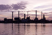 Sweet, Sunrise, oil refinery factory with reflection on the river. — Stock Photo
