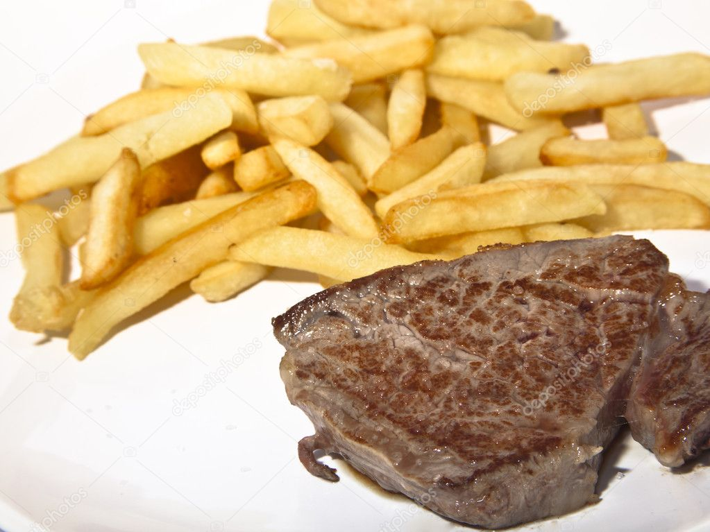 A sirloin with fried potatoes  Stock Photo #11805431