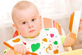 A small child learns to eat on his own — Stock Photo