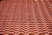 Red clay tiles roof pattern — Stock Photo