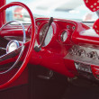 Stock Photo: Two Door 57 Chevy Red Interior