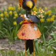 Royalty-Free Stock Photo: Girl Black Crow Dressed up Garden Statue