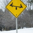 Stock Photo: Yellow Child on Teeter Tottler Sign