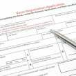 Stock Photo: Voter Registration Application with Silver Pen