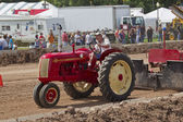Red & Yellow Cockshutt Tractor pulling Tracks — Stock Photo