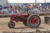 A red McCormick Deering Farmall Tractor — Stock Photo