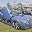 Постер, плакат: Chrysler 300 car with butterfly doors side view