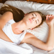 Young woman sleeping on the bed — Stock Photo