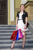 Shopping a young woman — Stock Photo