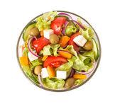 Close-up greek salad isolated on white — Stock Photo