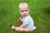 Cute baby on the grass — Stock Photo
