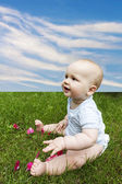 Lovely boy on the grass — Stock Photo