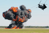 Helicopter over fite — Stock Photo