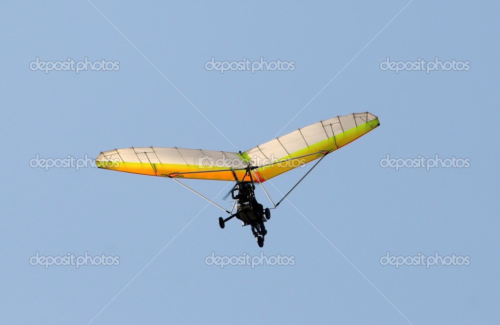 Ultralight airplane in flight against blue sky — Stock Photo #11632802