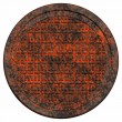 Rusty manhole cover - Stock Photo