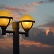 Stock Photo: Night lights at sunrise
