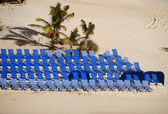 Beach resort with empty chairs — Stock Photo