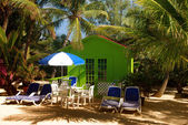 Colorful beach bungalow — Stock Photo