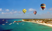 Hot air ballons over beach — Stock Photo