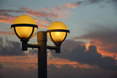 Night lights at sunrise — Stock Photo