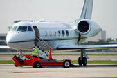 Airplane on runway — Stock Photo