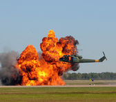 Helicopter near explosion — Stock Photo