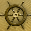 Boat wheel on sand — Stock Photo