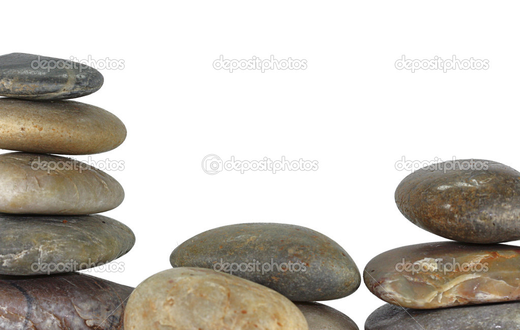 A pile of balancing rocks on white background — Stock Photo #11664820