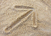 Arrow on sand — Stock Photo