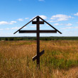 The lone cross in the field — Stock Photo