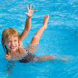 Happy girl int the swimming pool. — Stock Photo