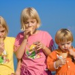 Ice-cream eating race - Stock Photo