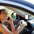 Stock Photo: Womdriver using mobile phone