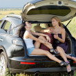 Women relaxing in boot of car — Stock Photo