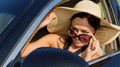 Female driver checking her side mirror — Stock Photo