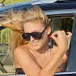 Windblown womin car — Stock Photo #11918463