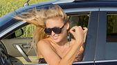 Windblown woman in car — Stock Photo