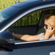 Woman driver talking on her mobile — Stockfoto