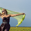Woman with scarf in the countryside — Stock Photo