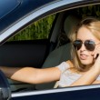 Young woman driver on her mobile — Stock Photo