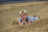 The young girl in hay — Stock Photo