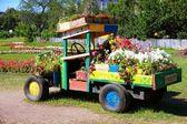 The Car a decor for a garden — Stock Photo